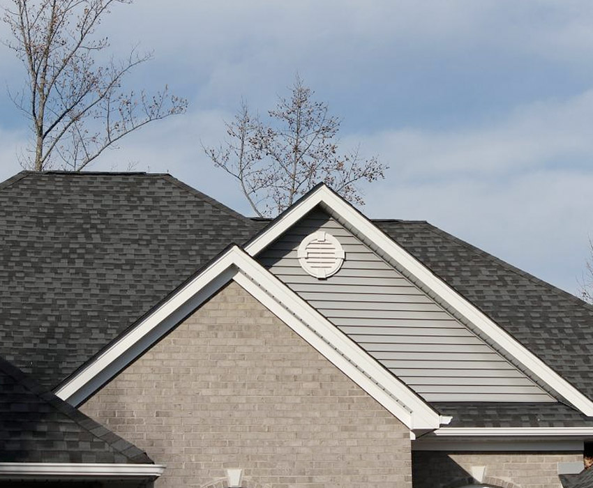 grey house with dark shingles