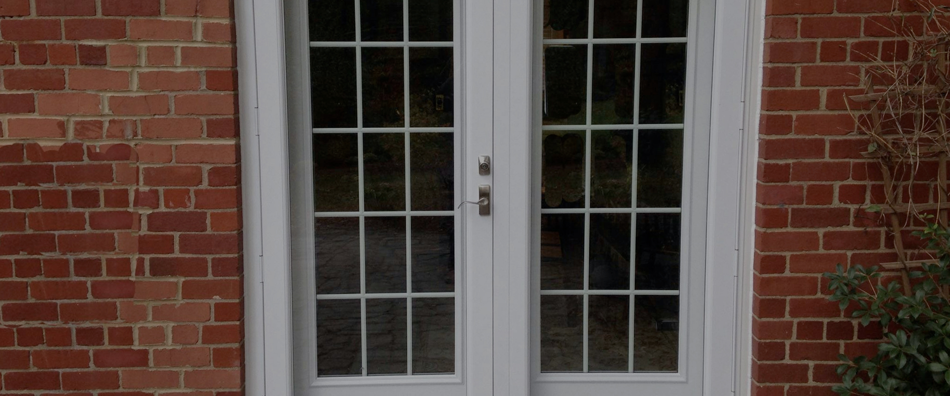 glass double doors on brick house